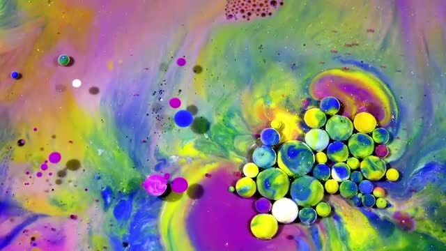 Colorful Ink Spheres On Oil 44: Stock Video