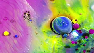 Colorful Ink Spheres On Oil 46: Stock Video