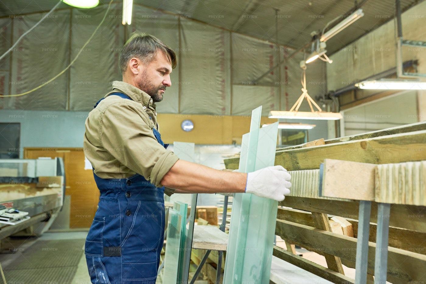 Mature Worker At Modern Furniture...: Stock Photos