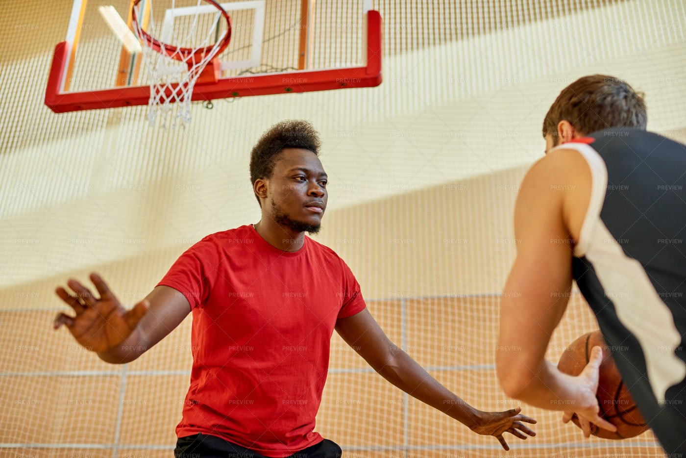 African Man Playing Defense In...: Stock Photos
