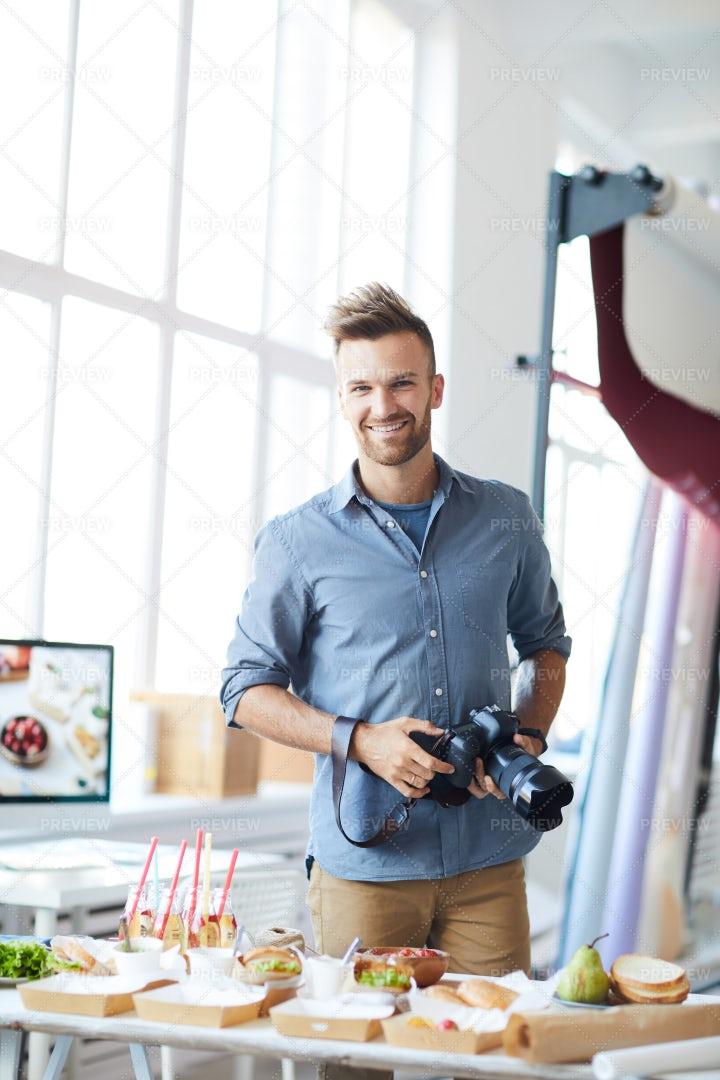 Handsome Photographer Enjoying Work: Stock Photos
