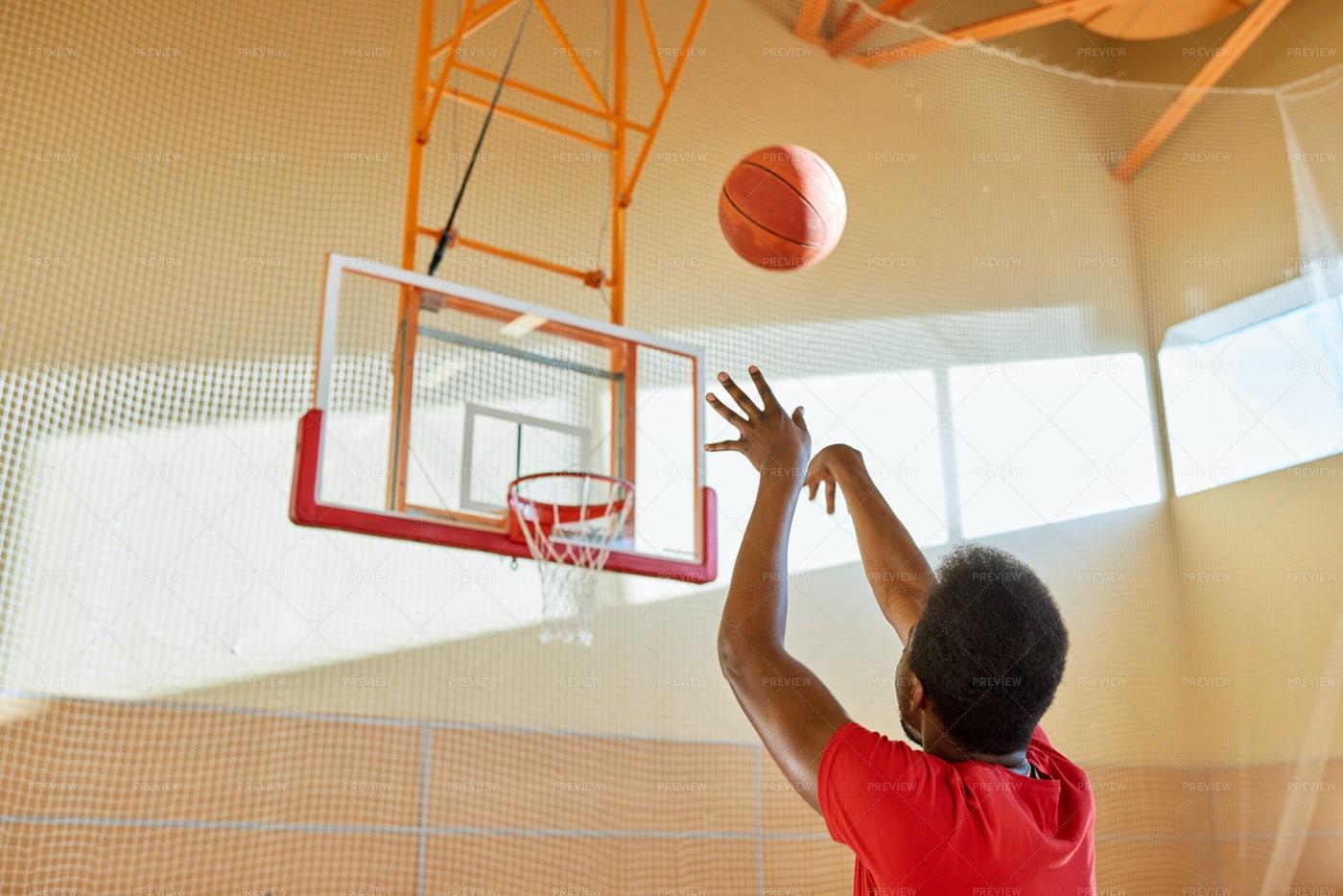 Tall African Man Shooting Ball At...: Stock Photos
