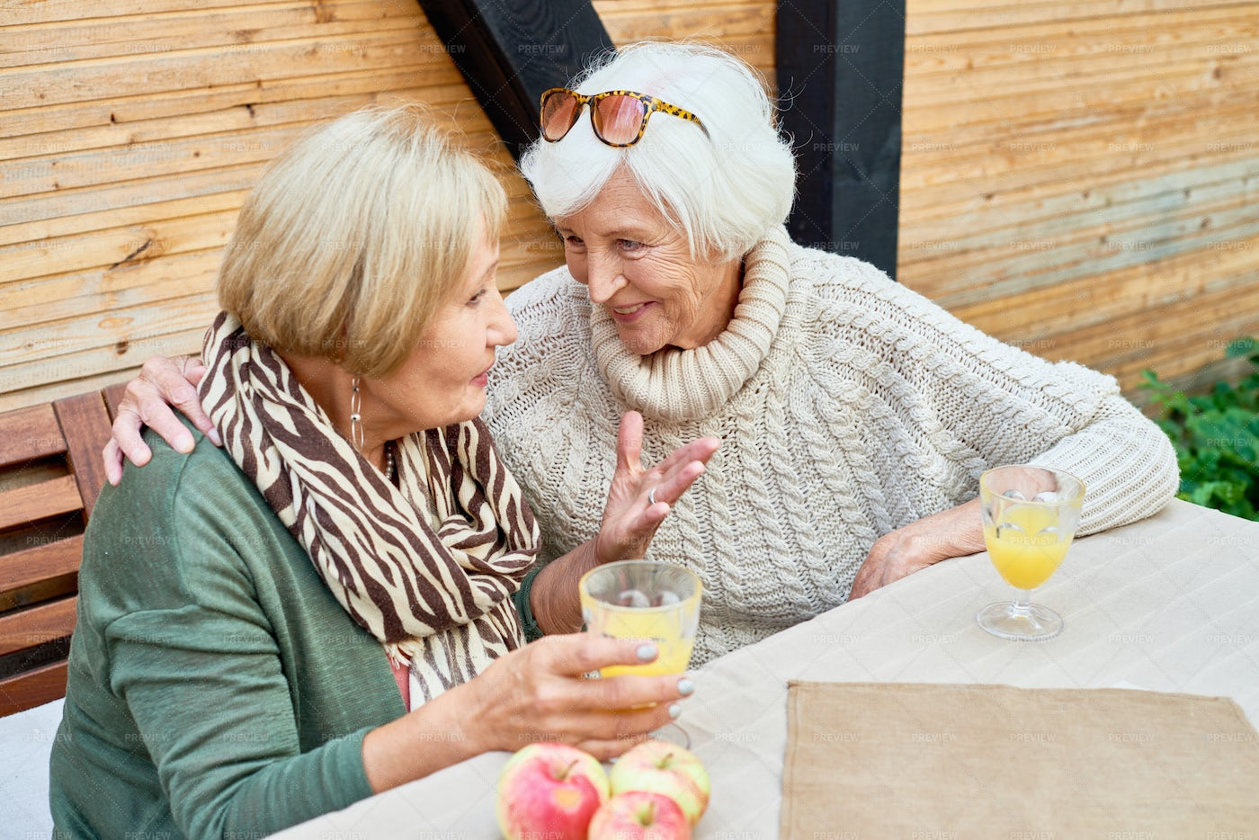 Senior Girlfriends In Cafe Together: Stock Photos