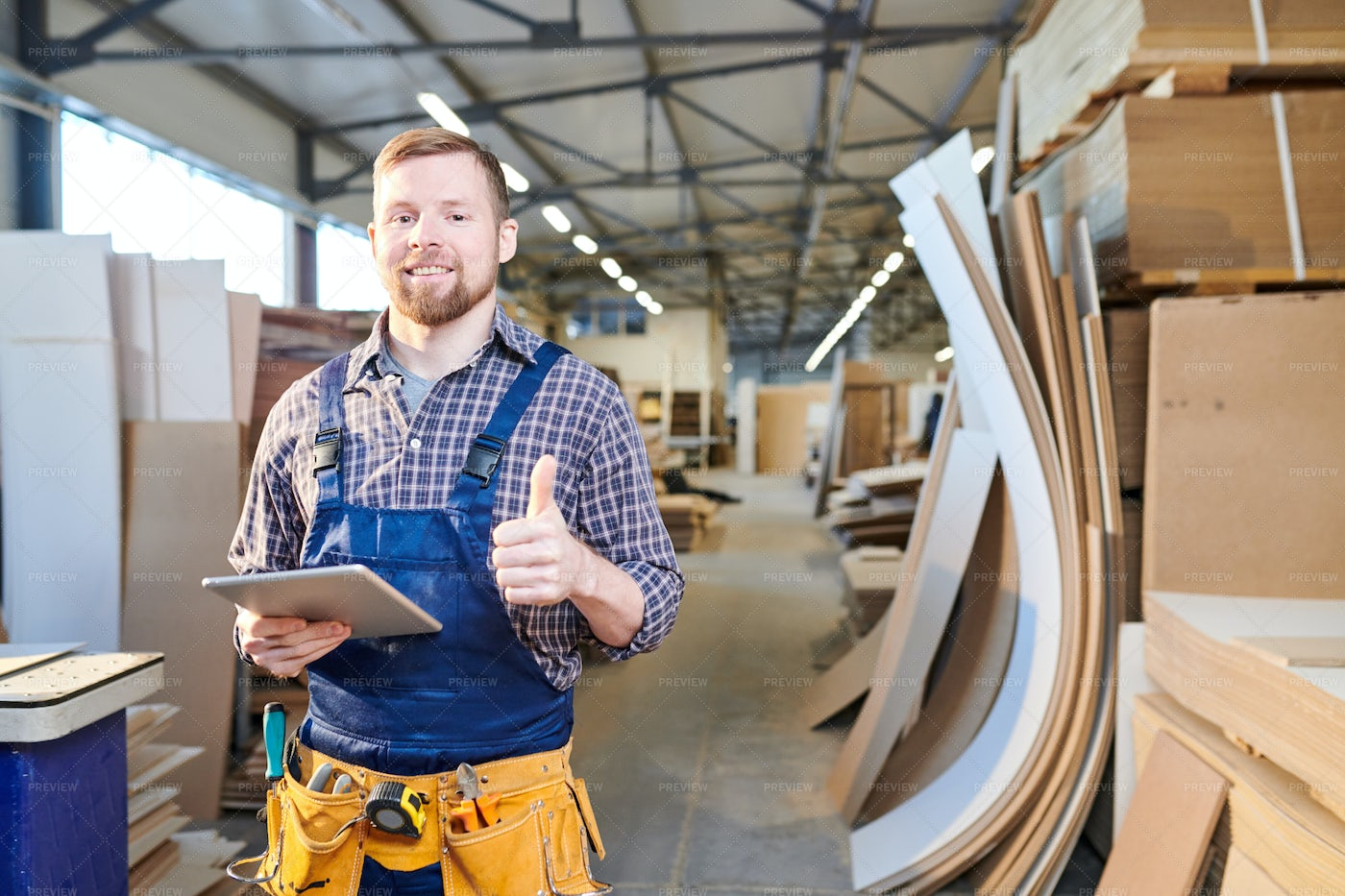 Happy Young Repairman Using Tablet...: Stock Photos