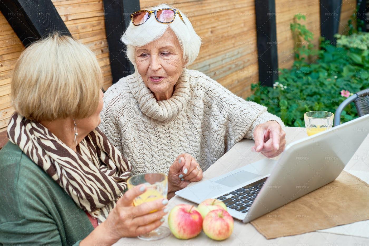 Two Senior Women Using Laptop...: Stock Photos