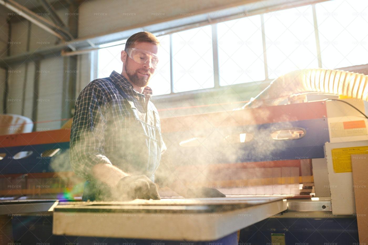 Bearded Employee Working In Dusty...: Stock Photos