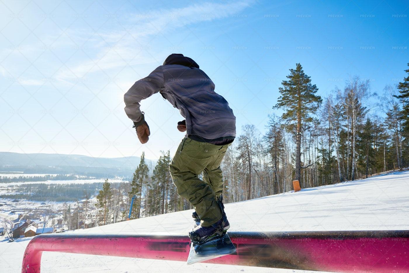 Snowboarder Riding On Rail: Stock Photos