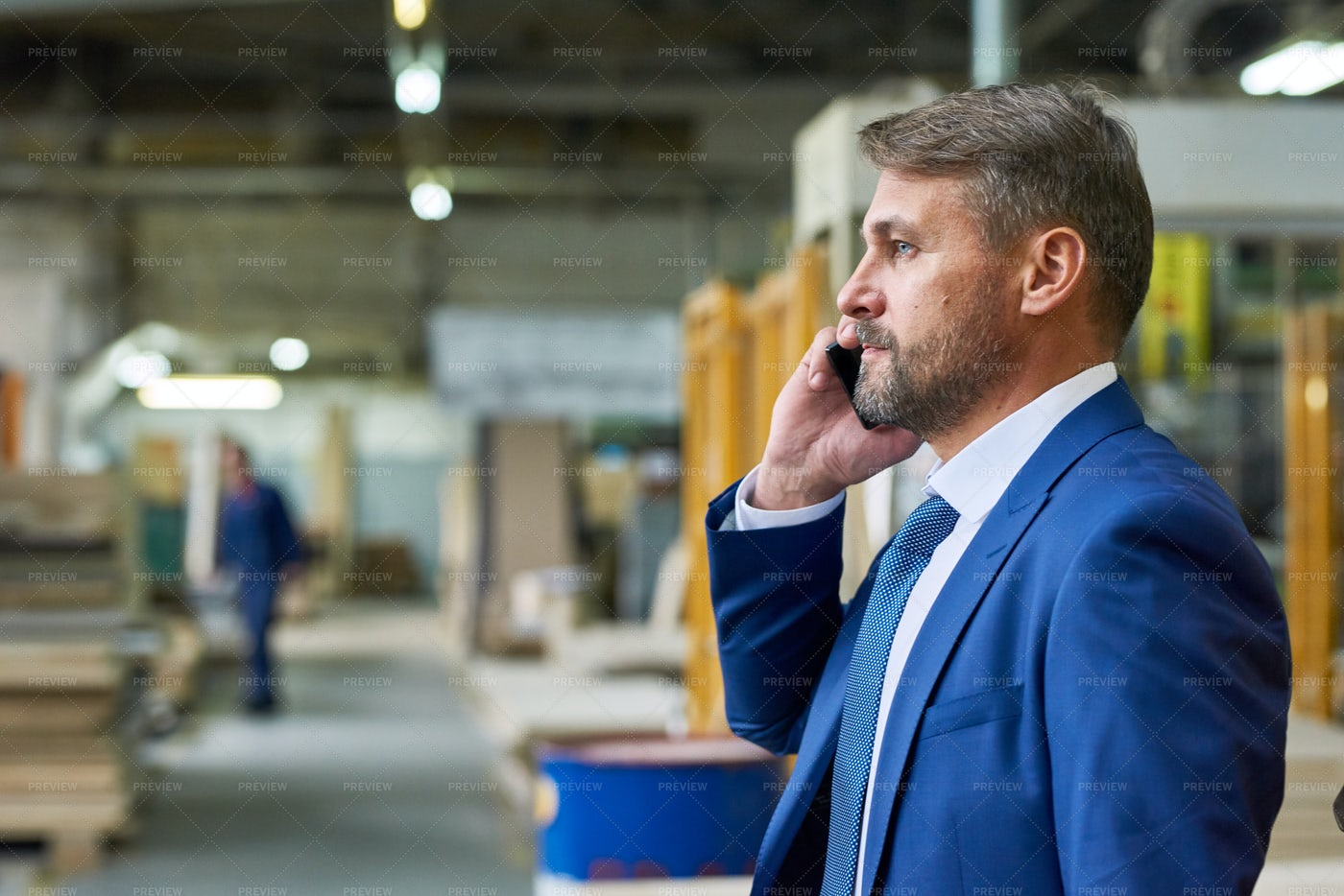 Manager Speaking By Phone In...: Stock Photos