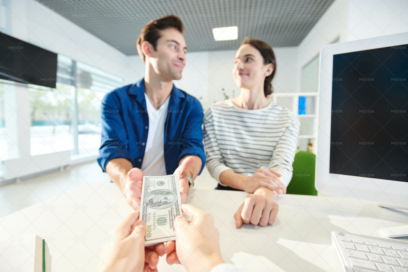 Taking Money From Bank To Live...: Stock Photos