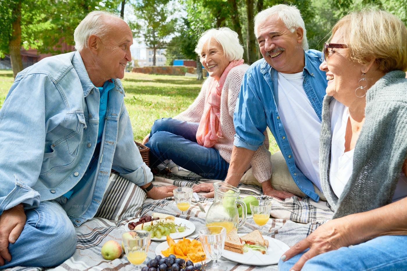 Senior People Enjoying Picnic In...: Stock Photos