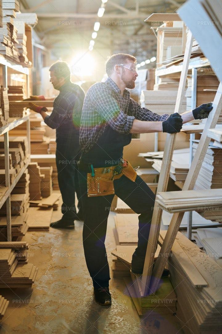 Busy Assemblers Choosing Wooden...: Stock Photos