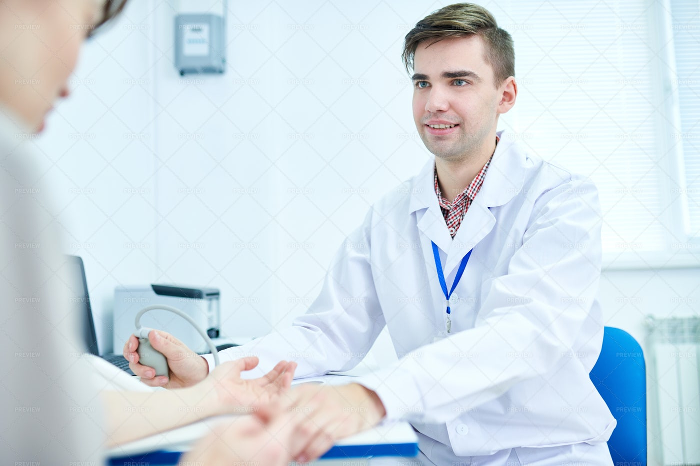 Young Doctor Measuring Blood...: Stock Photos