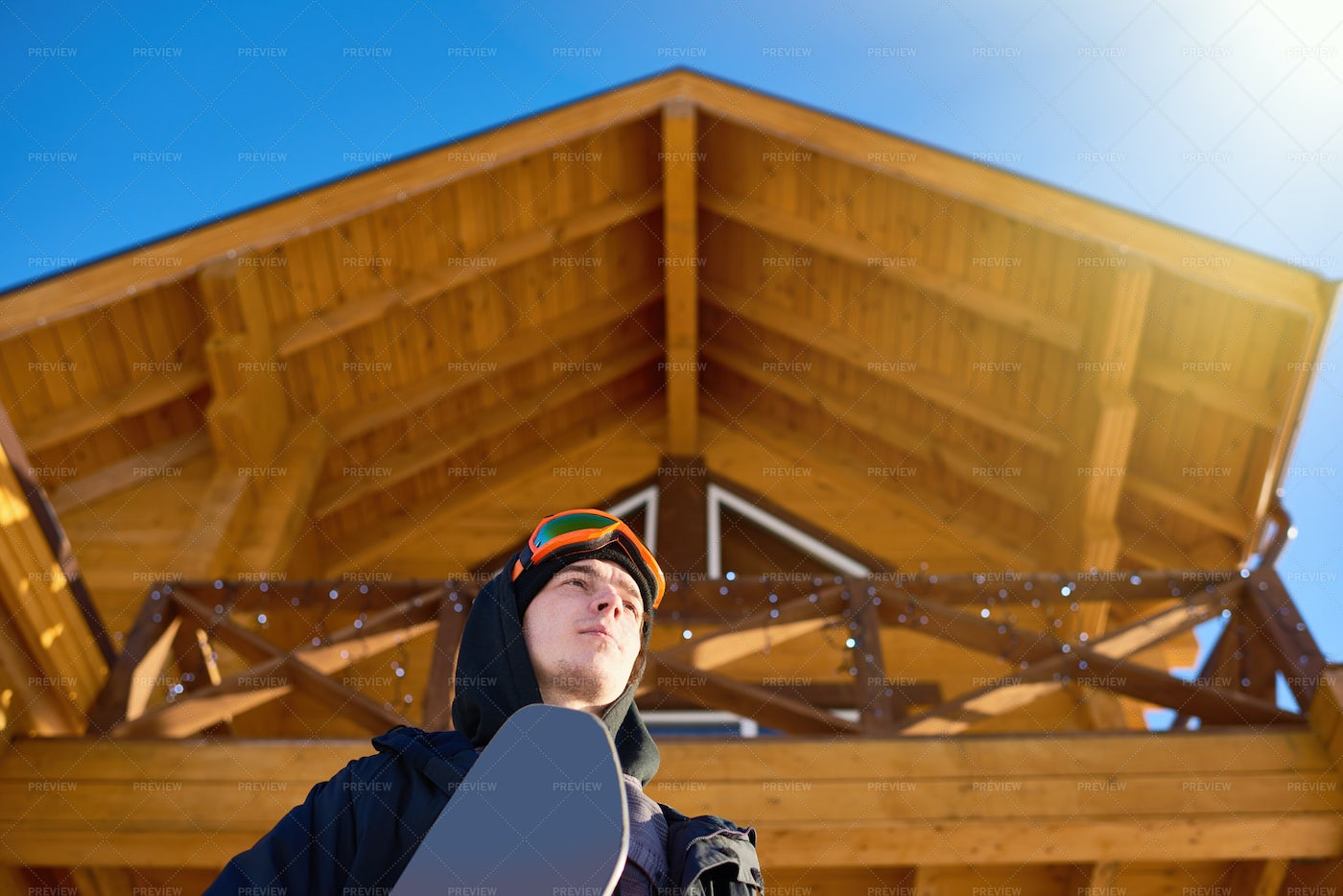 Snowboarder Leaving Chalet House: Stock Photos
