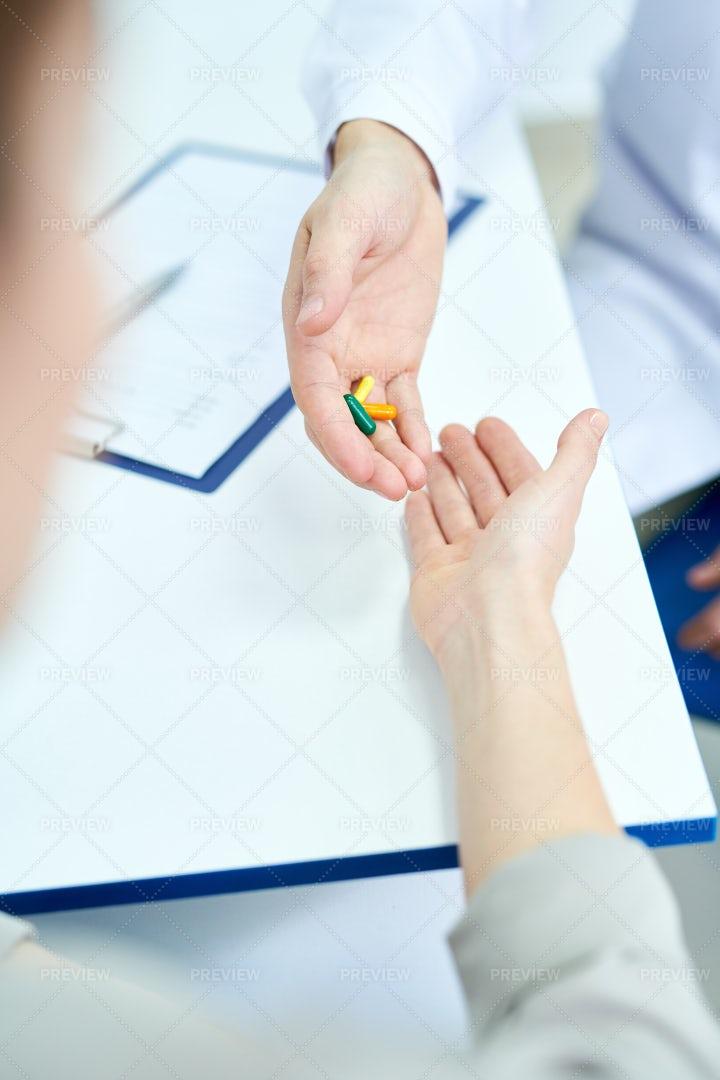 Doctor Giving Pills: Stock Photos