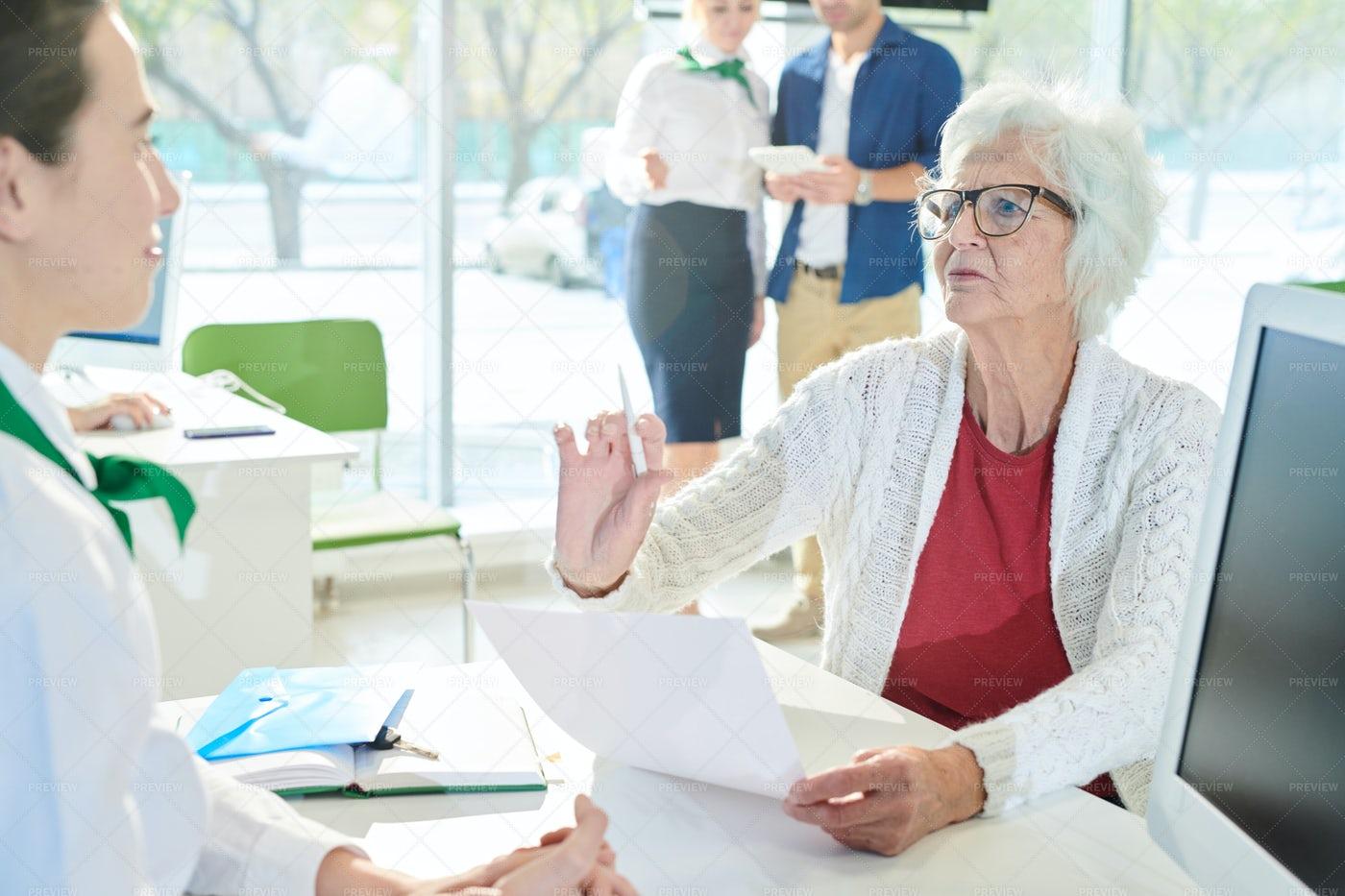 Displeased Senior Client Reading...: Stock Photos