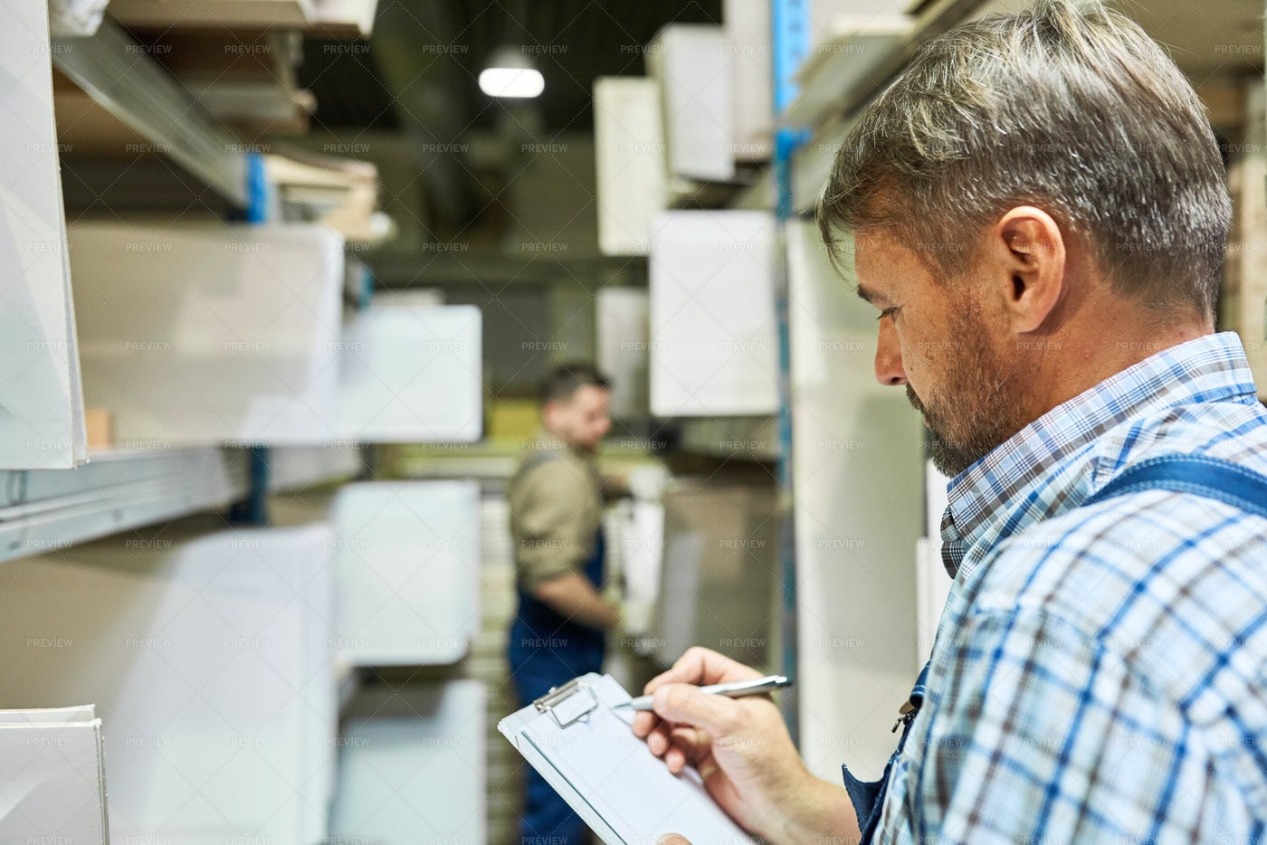 Workers  Doing Inventory In Storage: Stock Photos