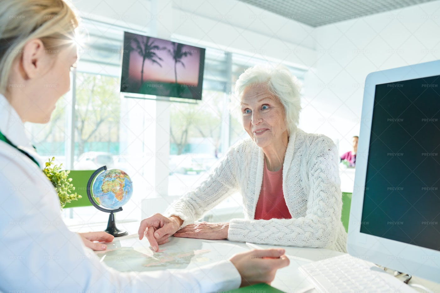 Excited Senior Lady Asking About...: Stock Photos
