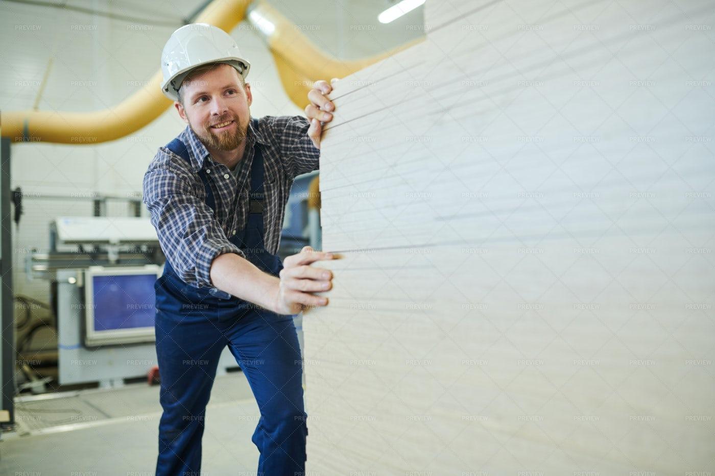 Happy Man Enjoying Manual Work At...: Stock Photos