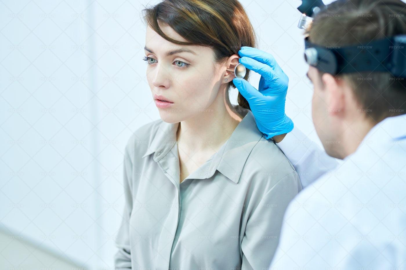 Audiologist Examining Hearing: Stock Photos