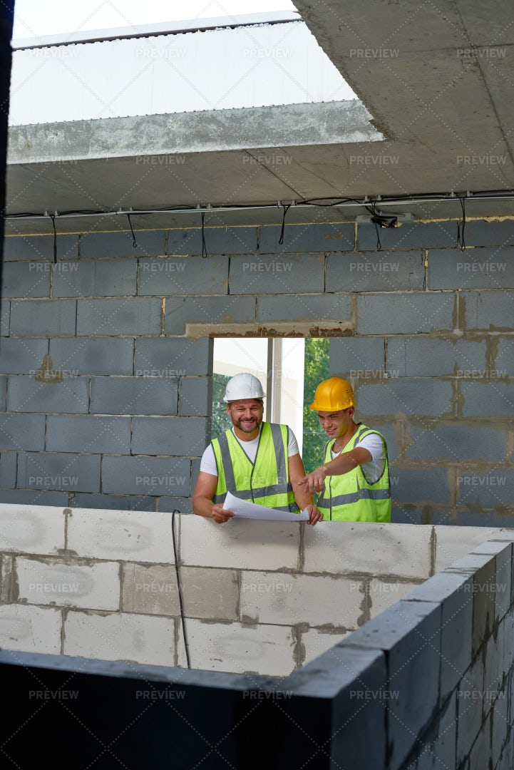 Cheerful Construction Workers On...: Stock Photos