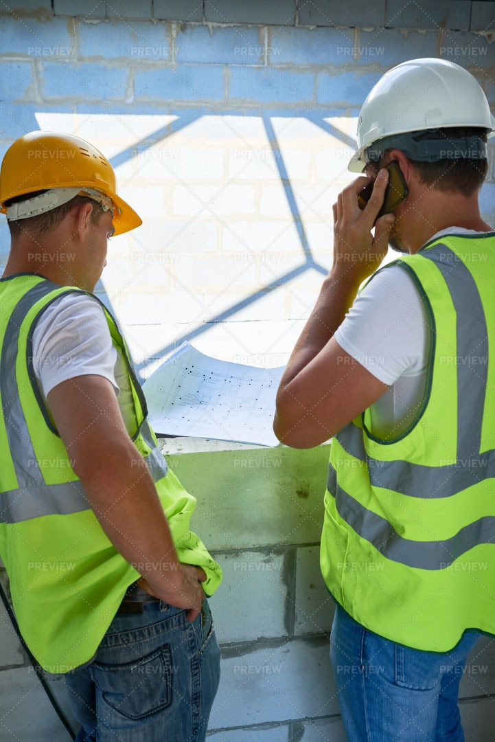 Workers With Floor Plans: Stock Photos