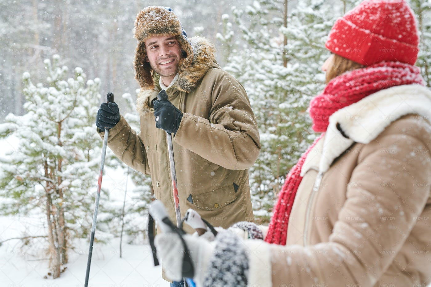 Happy Couple Skiing In Forest: Stock Photos