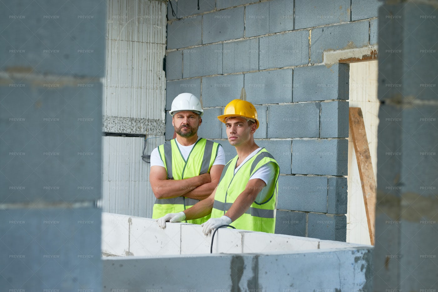 Construction Workers Posing On Site: Stock Photos