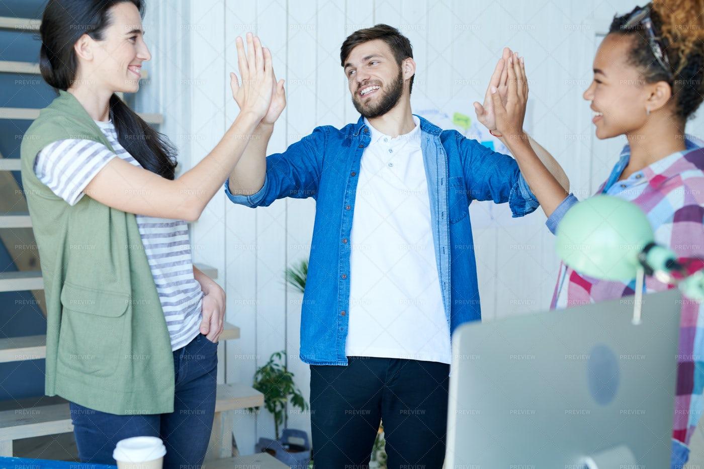 Young Entrepreneurs Doing High Five: Stock Photos