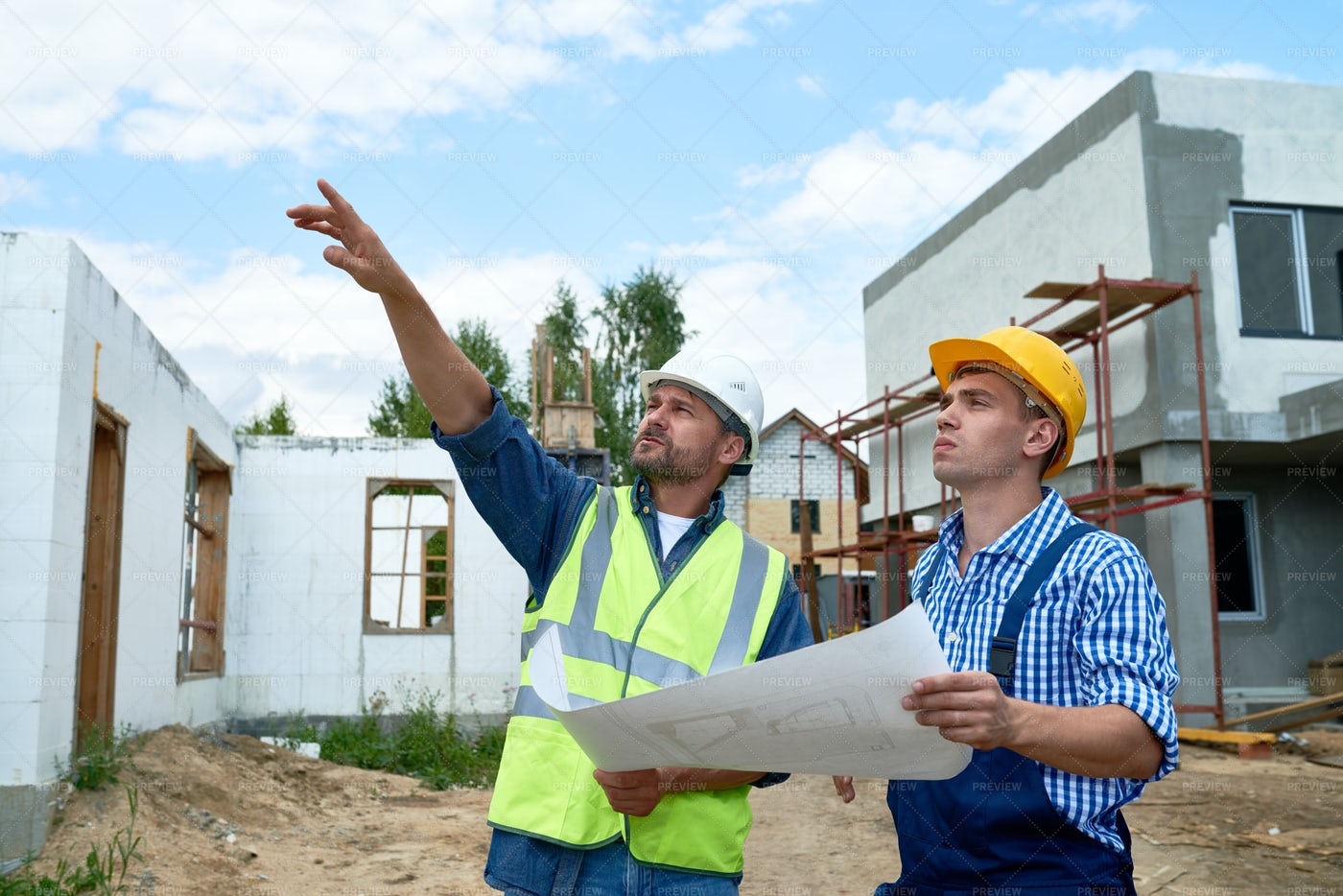 Foreman Overseeing Building...: Stock Photos