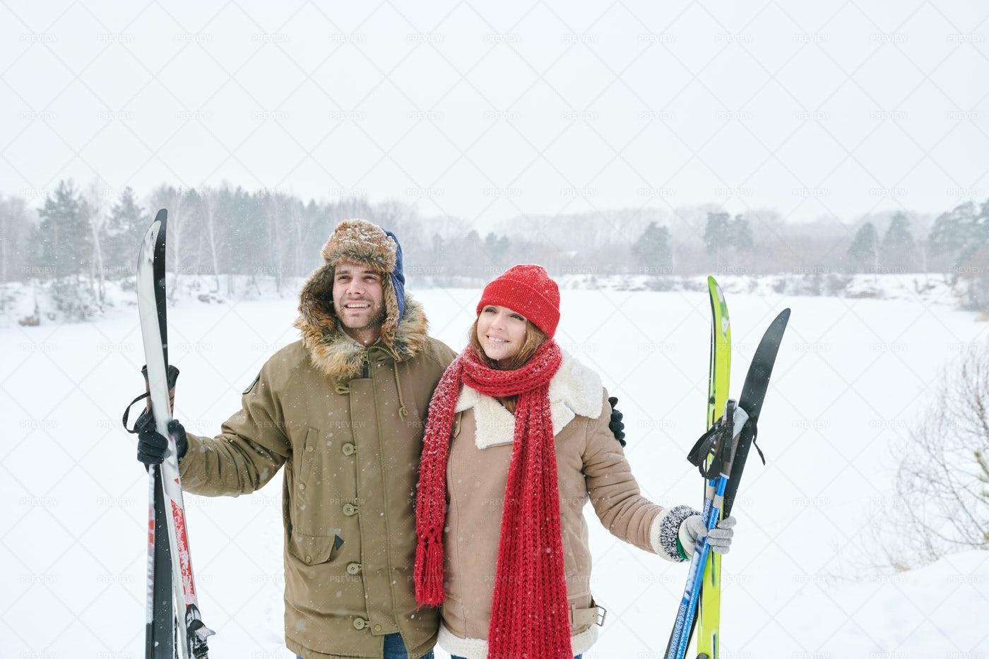 Smiling Couple Holding Skis: Stock Photos