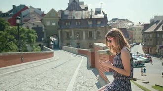 Young Lady Using A Phone Outdoors: Stock Video