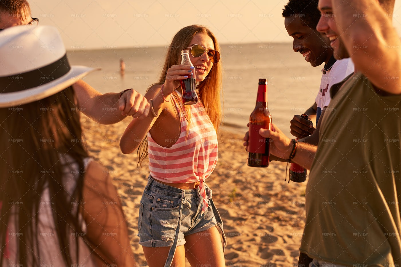Carefree Friends Drinking Beer At...: Stock Photos