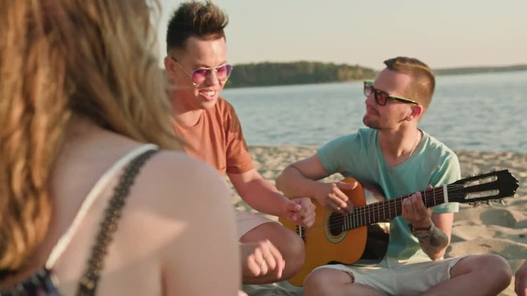 People Having Fun At The Beach: Stock Video