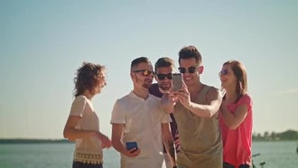 Young People Taking Selfie On The Beach: Stock Video