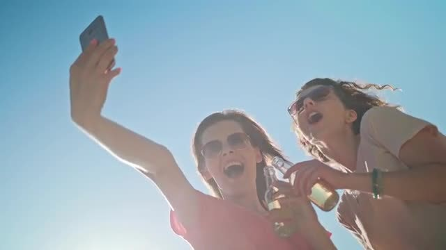 Young Ladies Taking A Selfie: Stock Video