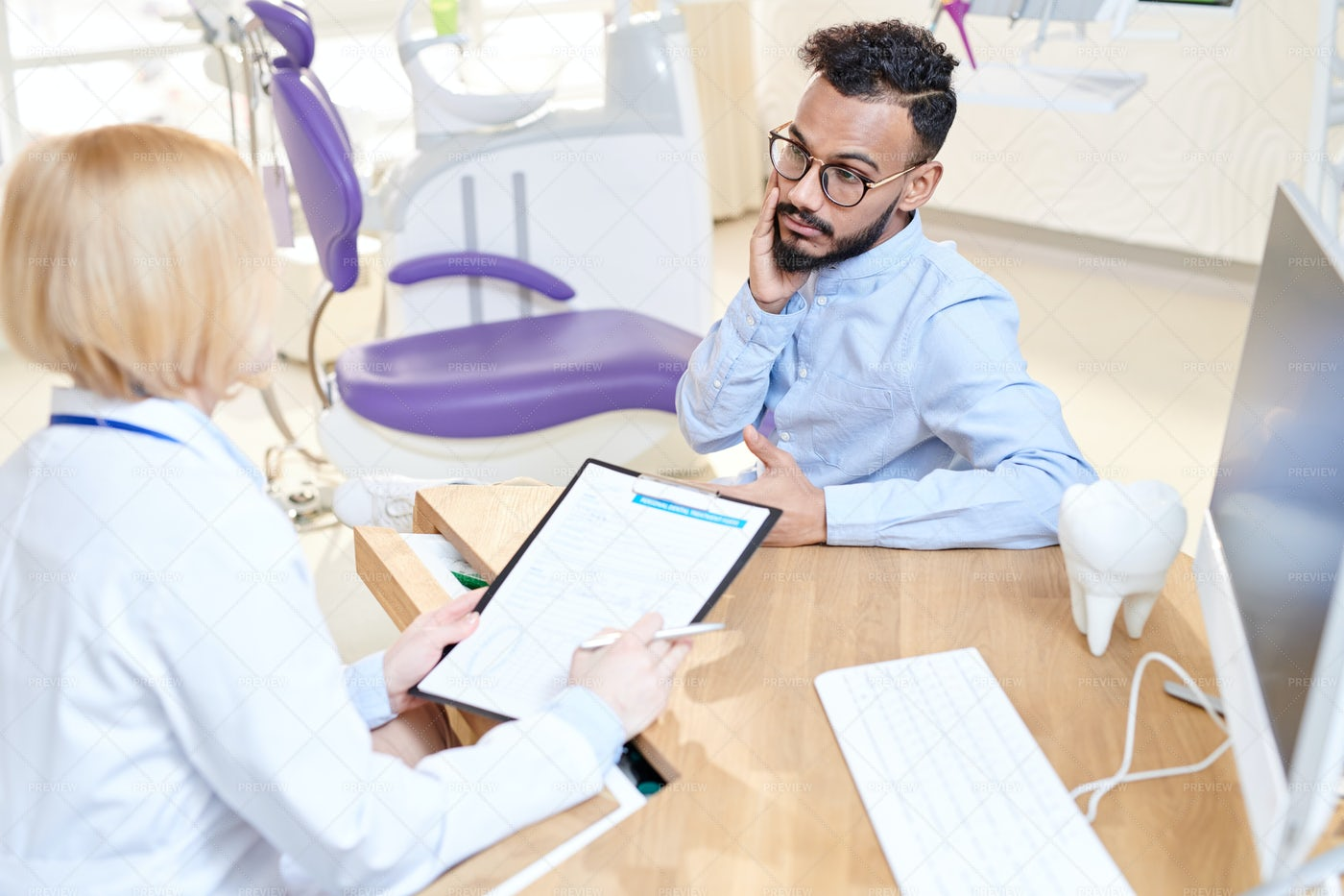 Discussing Treatment With Patient: Stock Photos