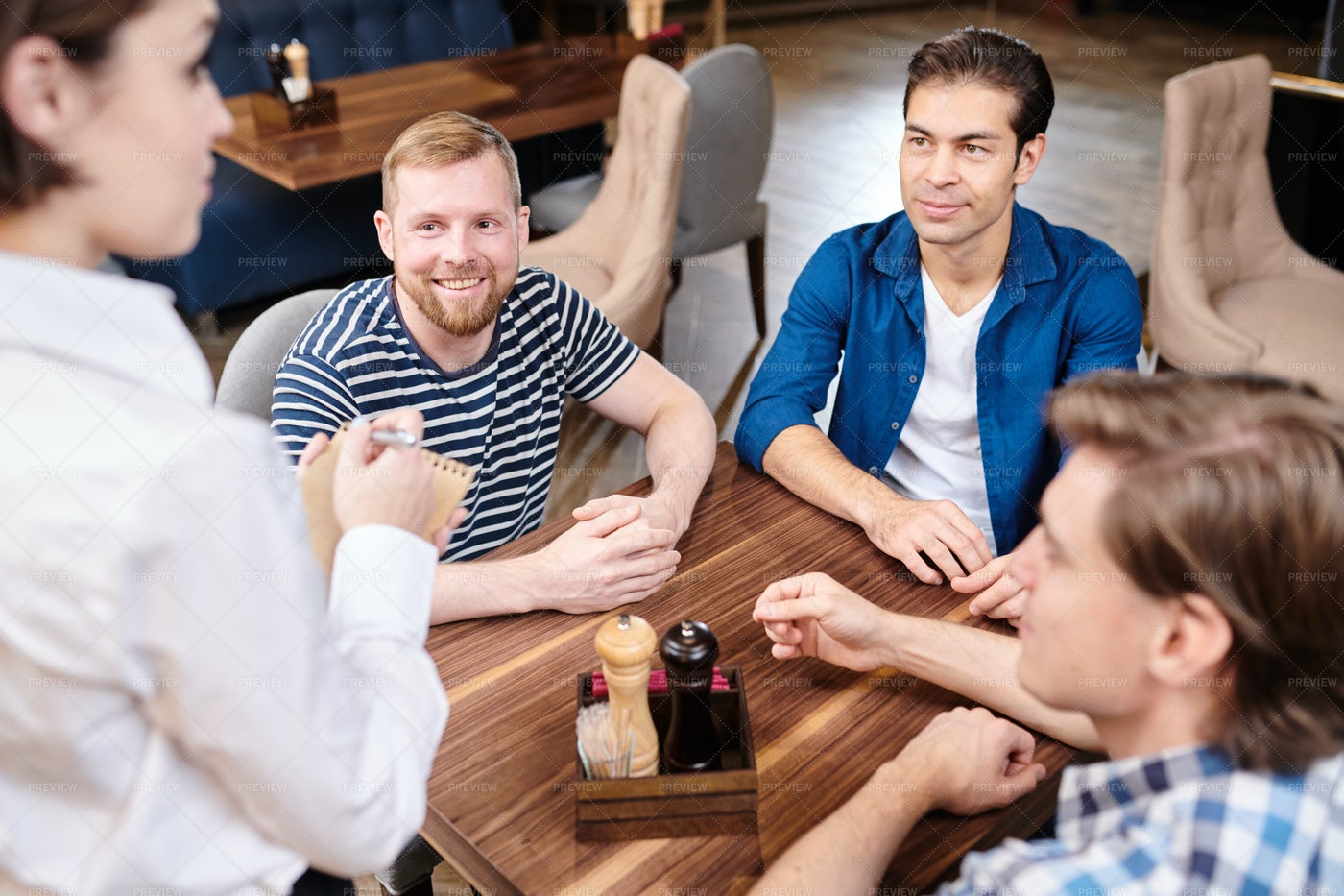 Positive Young Friends Making Order...: Stock Photos