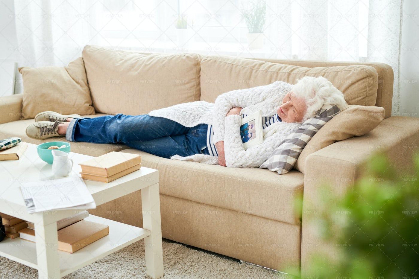 Depressed Senior Woman Remembering...: Stock Photos
