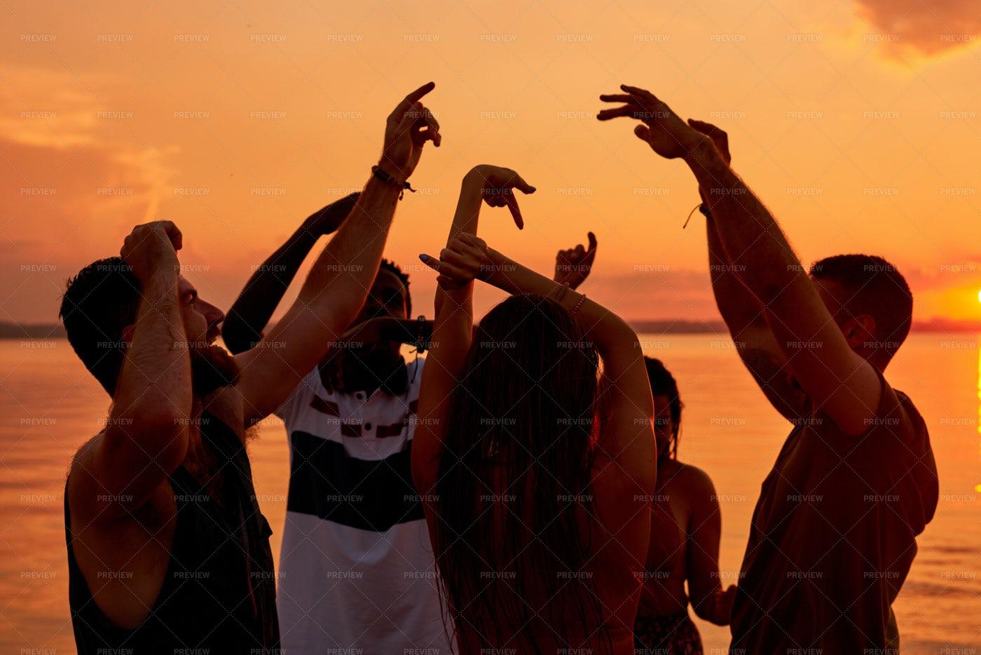 Carefree Energetic Friends Dancing...: Stock Photos