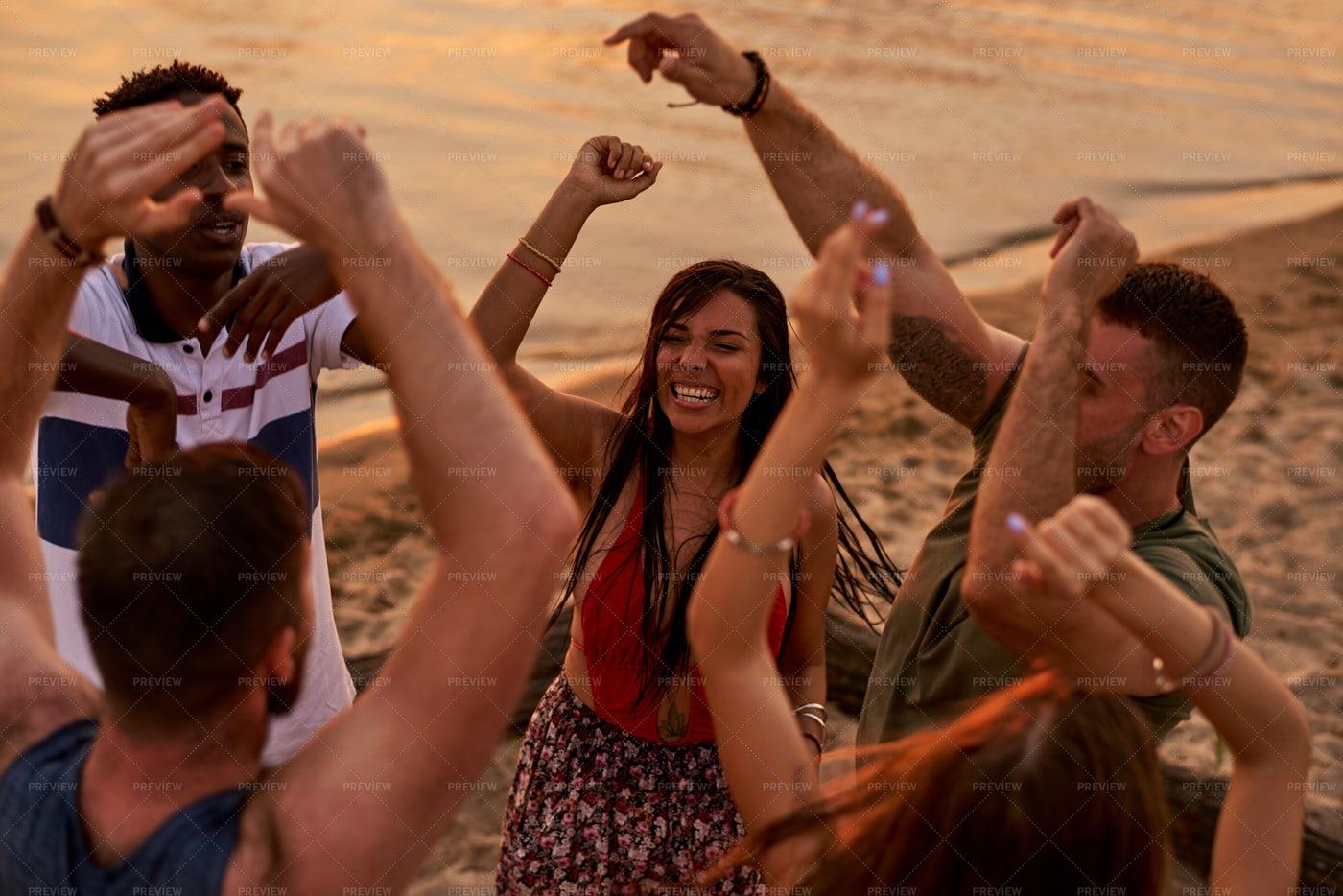 Interracial Friends Dancing In...: Stock Photos