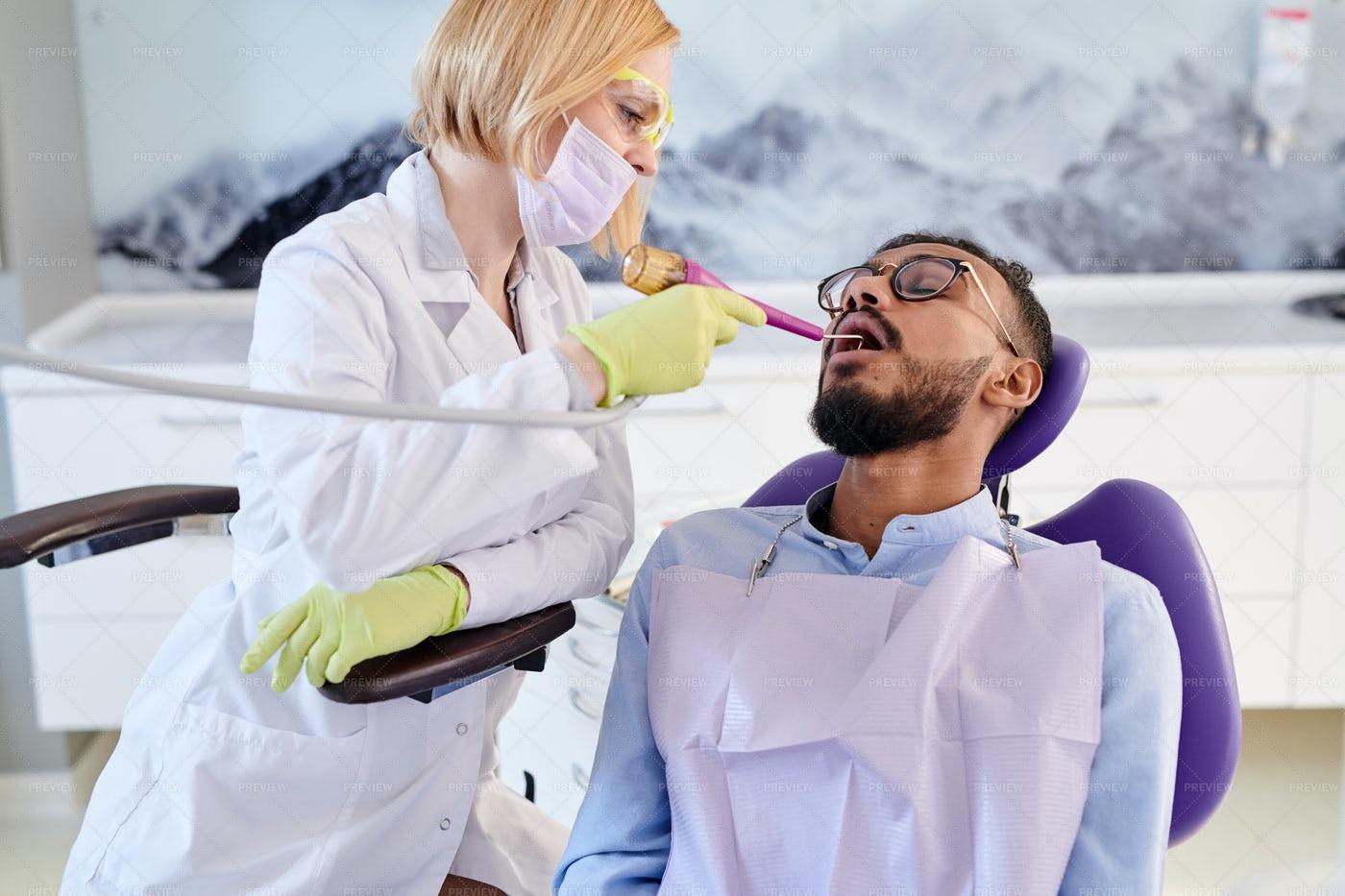 Undergoing Teeth Polishing: Stock Photos