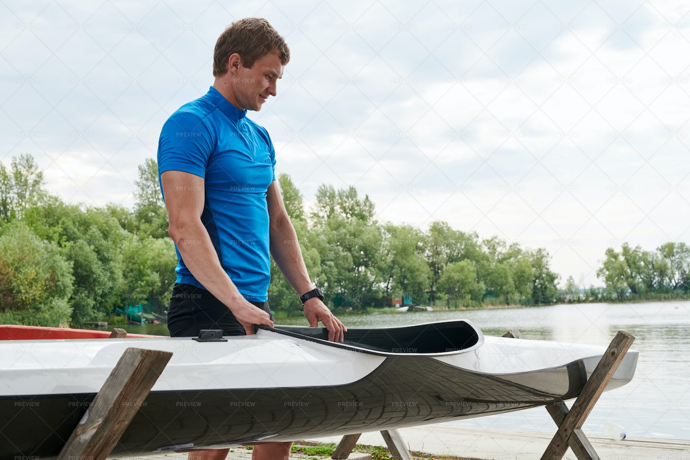 Kayaker Standing With Boat: Stock Photos