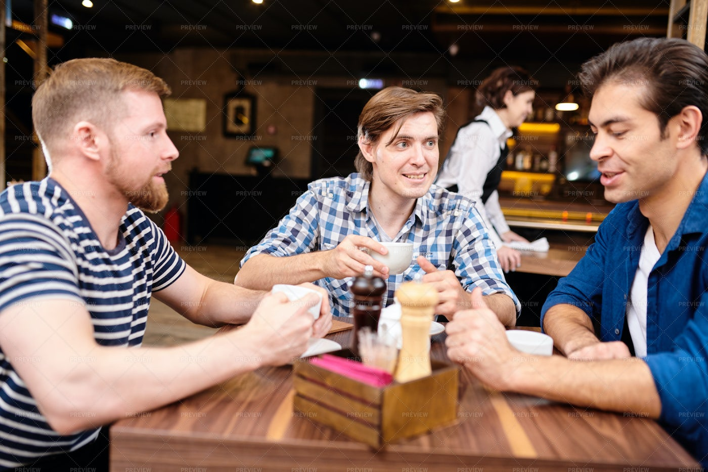 Positive Young Men Talking At Lunch: Stock Photos
