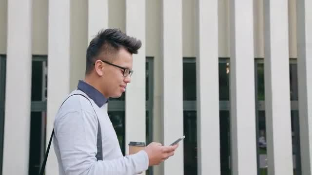 Young Man Using Phone: Stock Video