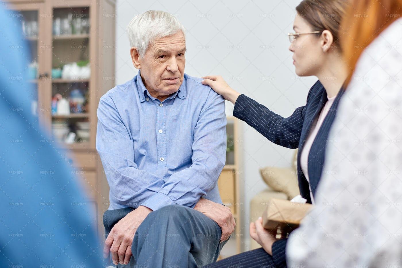 Comforting Senior Patient: Stock Photos