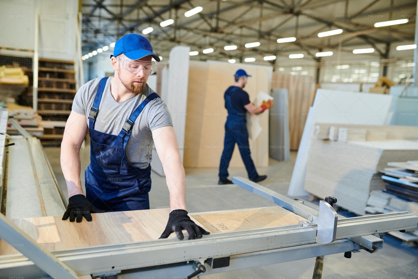 Handsome Worker Measuring Wooden...: Stock Photos