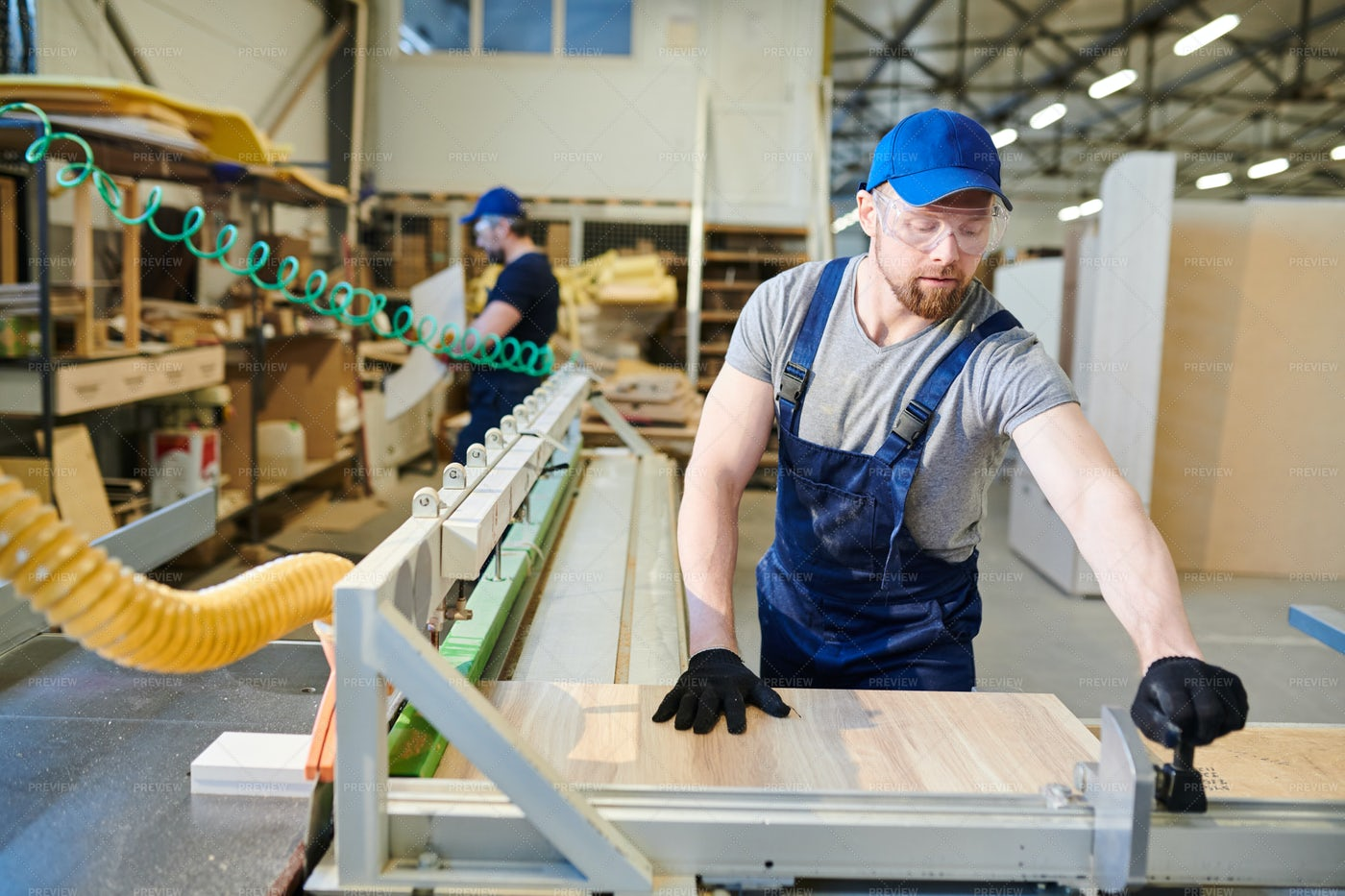 Busy Man Working At Furniture...: Stock Photos
