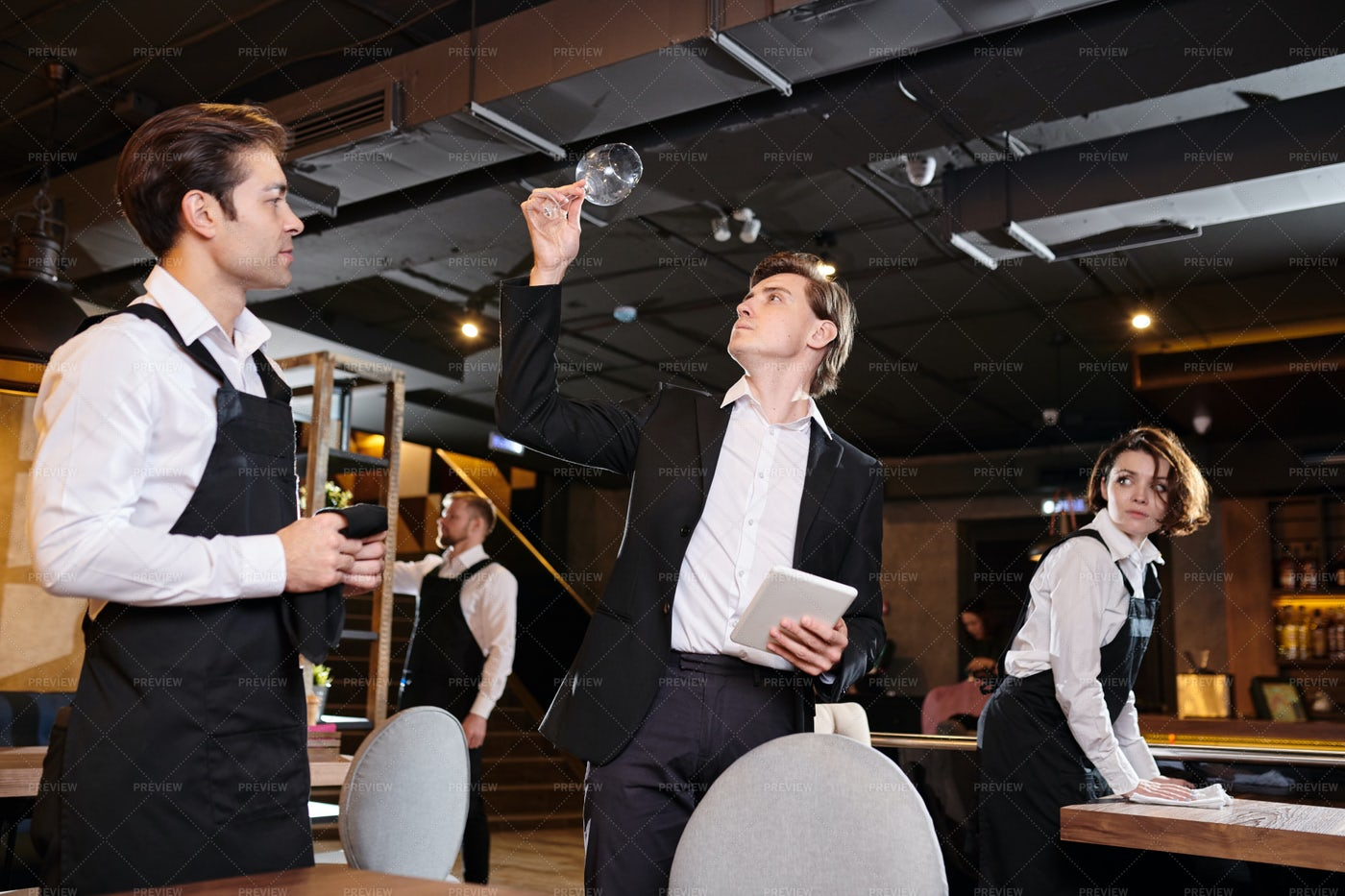 Professional Restaurateur Checking...: Stock Photos