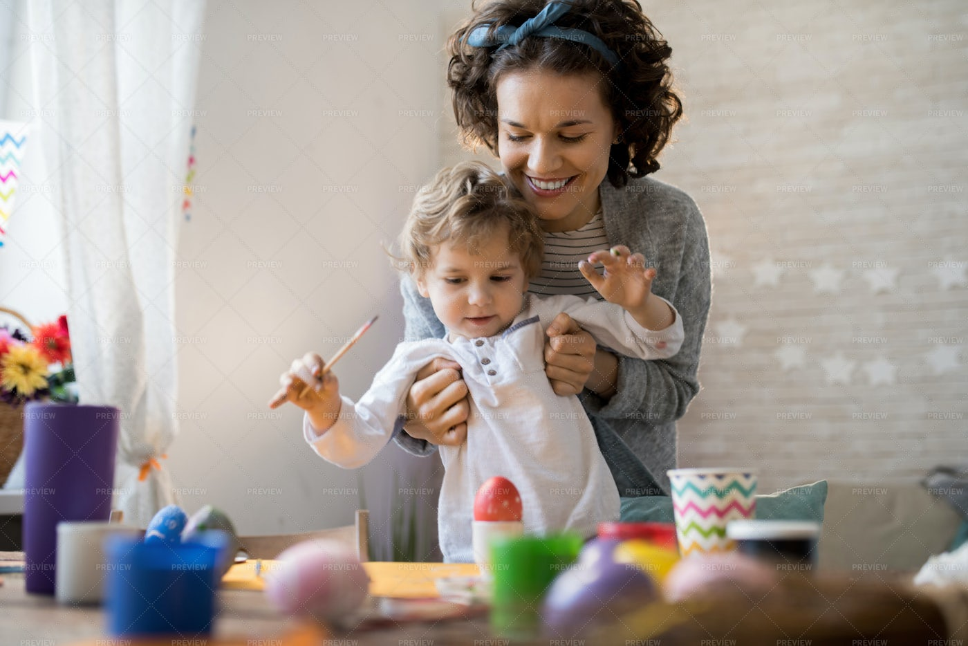 Mother Painting Easter Eggs With...: Stock Photos