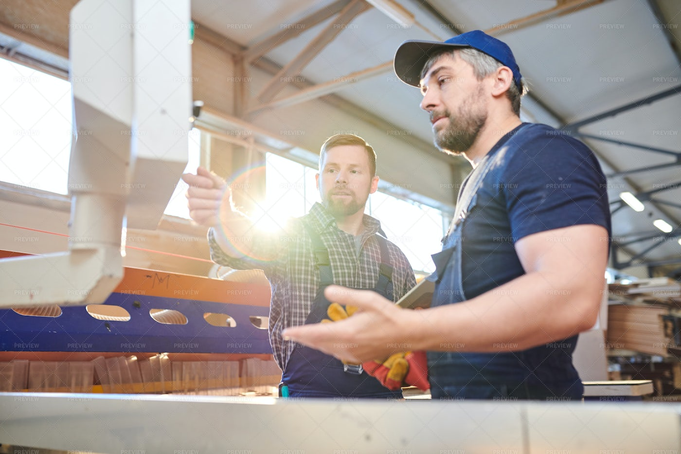 Factory Engineers Discussing...: Stock Photos